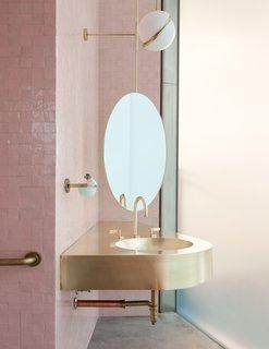A brass sink makes a stylish statement.