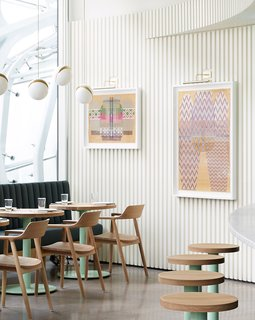 Colorful artwork adds some personality to the restaurant's textured, white walls.