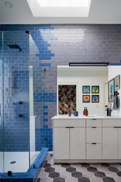 For the bathroom, Puyana laid two tones of gray tiles in diagonal stripes, bringing something unexpected to an otherwise pedestrian material.