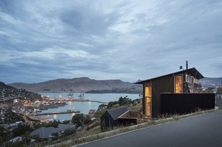 Equal parts home and office, the studio retreat boasts expansive views of Lyttelton Harbor.