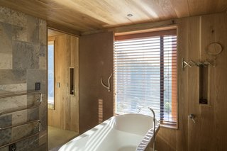 Thoughtful touches, like a spacious standalone bathtub, turn this retreat into a peaceful escape.
