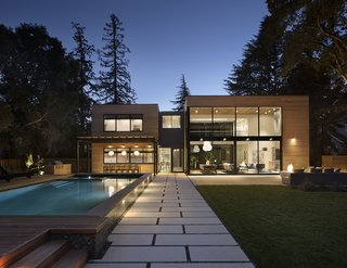 Large walls of glass gives the home a light box effect at night.