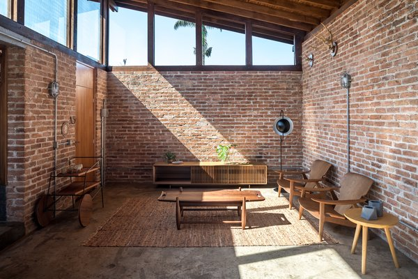 The brick used in construction of the social structure were taken from a deconstructed factory once belonging to the homeowners.