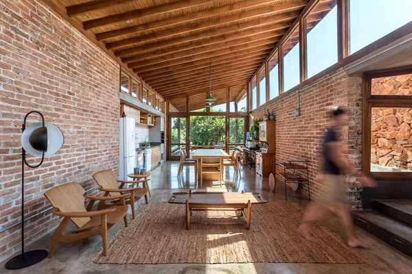The interior of the social side of the home was made to feel like a communal pavilion, with all of the activities grouped in one fluid space and clerestory windows invoking an open-air aspect.