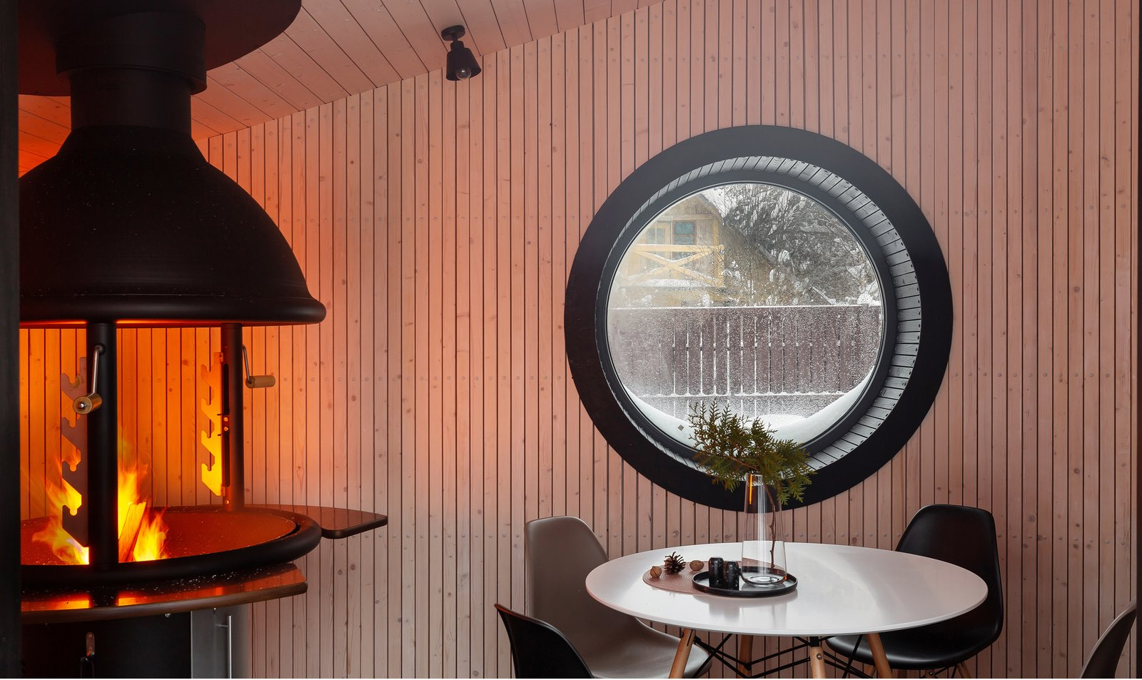 The first FLEXSE prototype is laid out as a classic grill house with an integrated barbecue—but the designers say the building can be used for any small-scale purpose, such as a sauna, guest house, or office pod.  Photo 3 of 9 in A Modern Tiny House Reinvents the Finnish Barbecue Hut