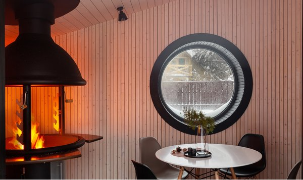 A modern take on the Scandinavian grill house, FLEXSE by St. Petersburg–based designers SA Lab is a sophisticated micro dwelling with an impressive list of seasonal adaptations. The cozy and comfortable modular house is the ideal place to retreat to during winter months, given its cubby-hole ambiance. In warmer weather, cuddling up inside can be exchanged for lounging on the open terrace outside. The modular design is adaptable for different purposes—it can serve as a sauna, a guest dwelling, and even a complete tiny house.