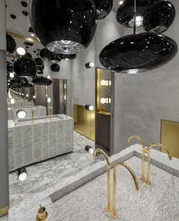 Thanks to the help of British designer Tom Dixon, the newly opened Manzoni in Milan has become so much more than just a restaurant. This theatrical backdrop is a must-see for design enthusiasts—especially the restroom, which features Dixon's whimsical black copper pendants suspended from the ceiling, and floor-to-ceiling mirrors that face each other to create a dizzying infinity effect.