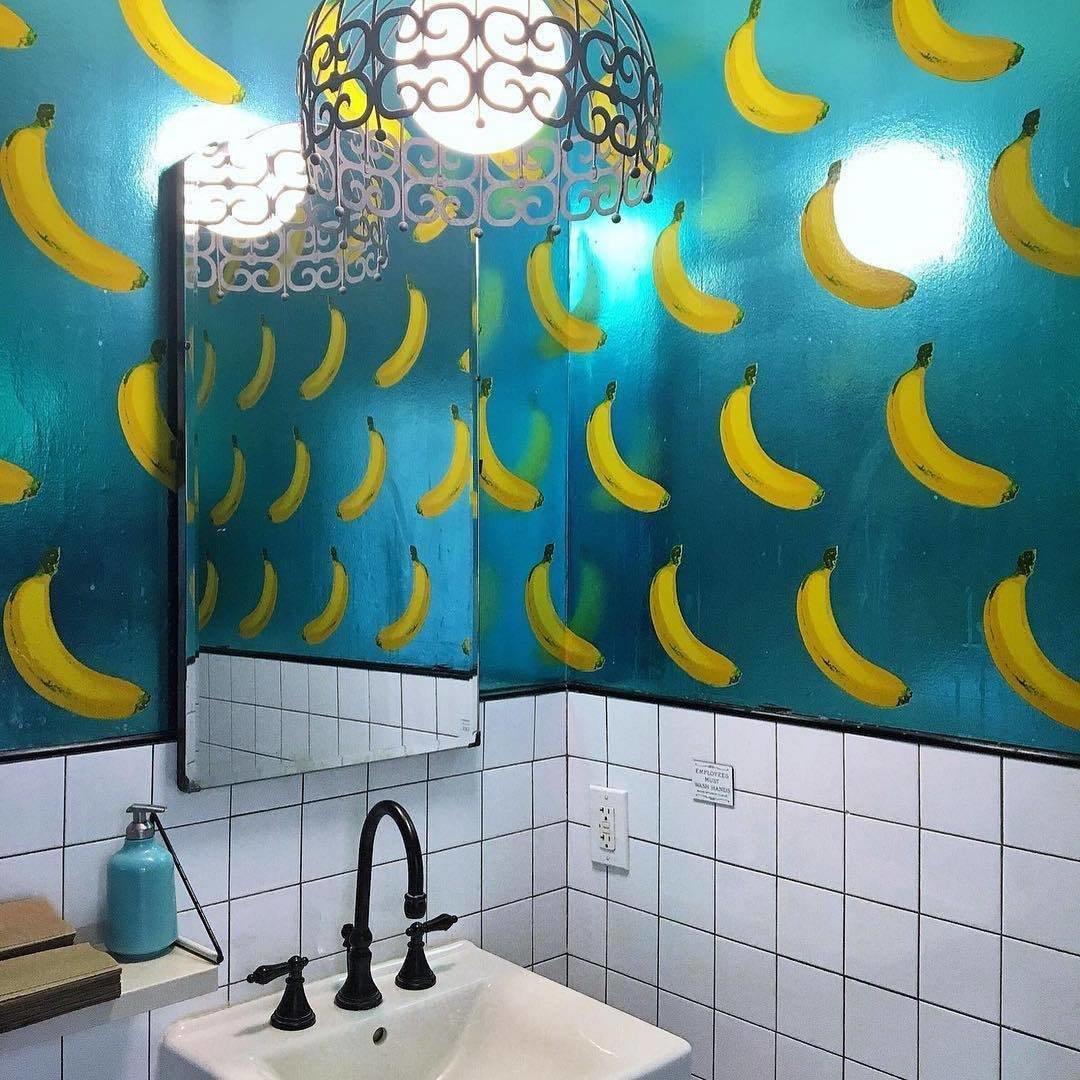 Media Noche bathroom with banana pattern wallpaper.