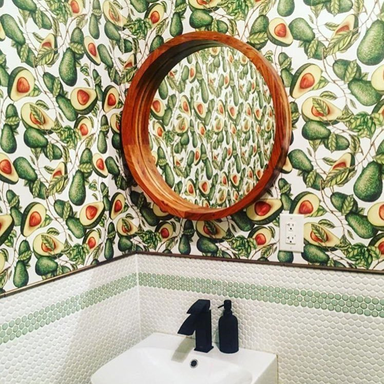Charley St. restaurant bathroom with avocado print wallpaper
