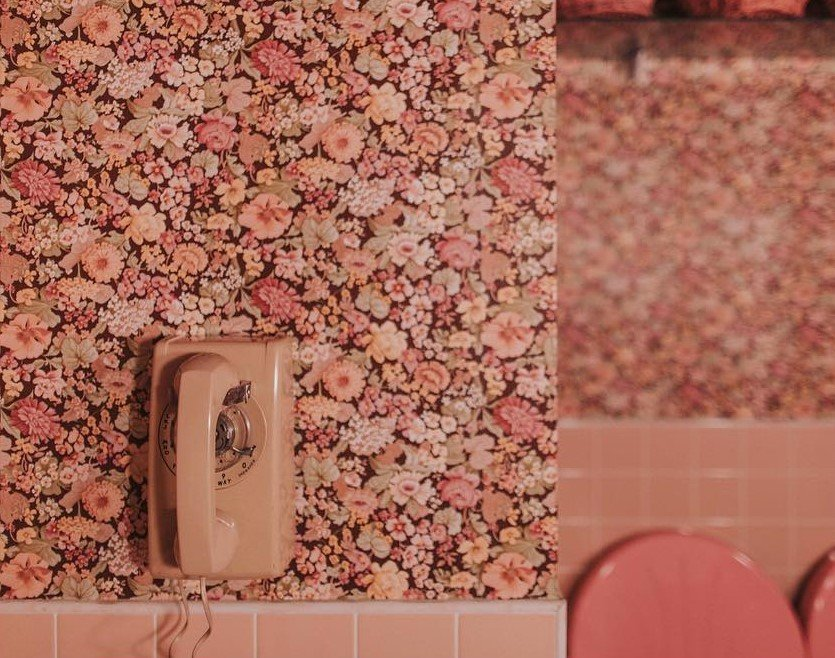 Motel Morris bathroom with pink floral wallpaper