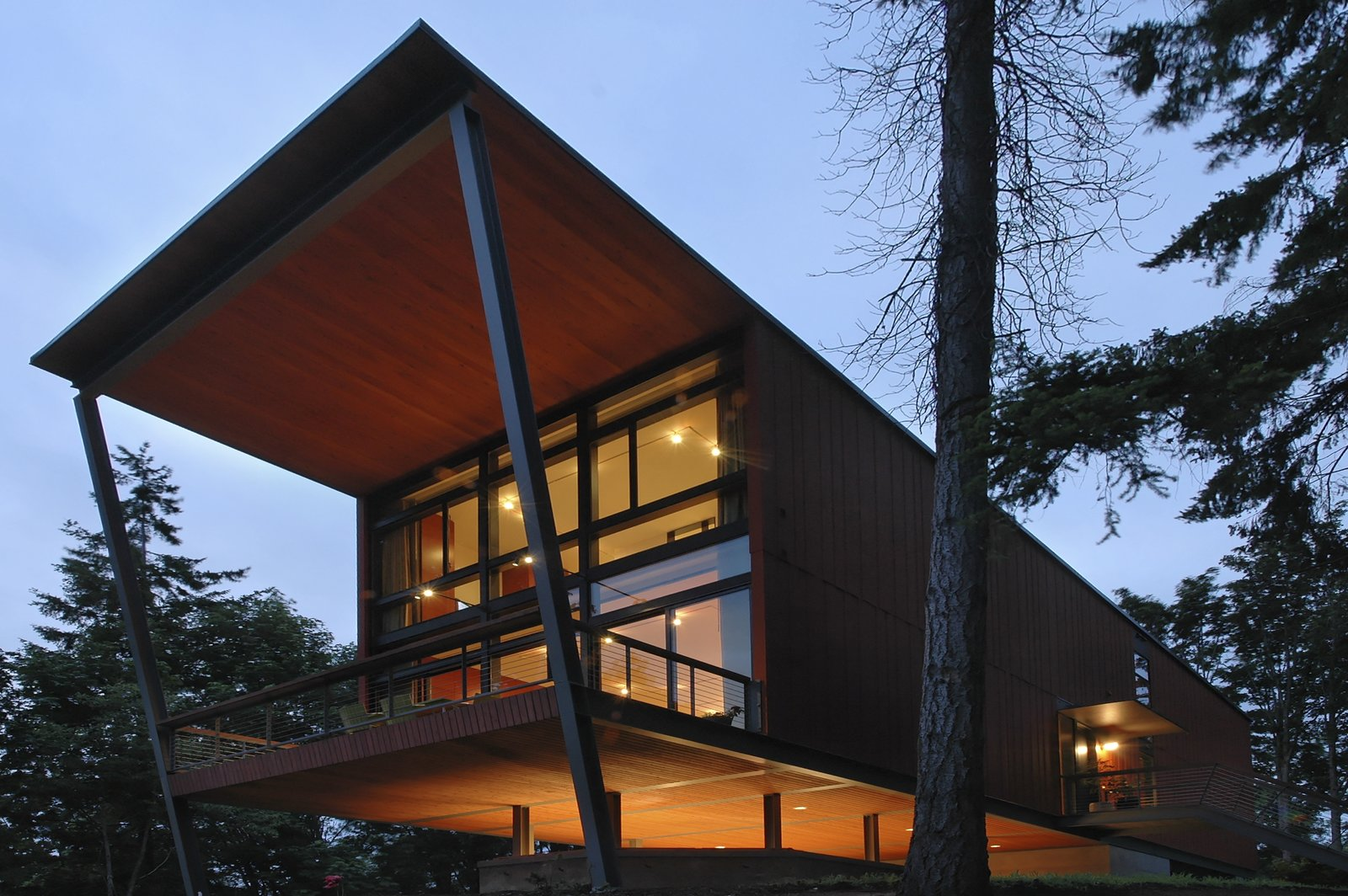 Exterior The home cantilevers out over its historic bunker base.   Photo 1 of 8 in A Cantilevered Bainbridge Island Home Set Atop a Historic Bunker Lists For $1.73M from Stunning Steel-Frame Construction Cantilevered atop Historic Bunker For Sale