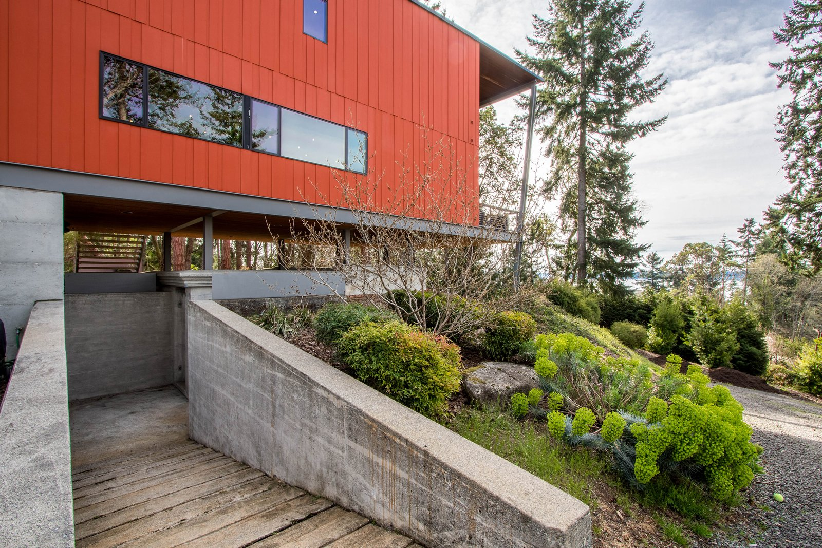 Exterior The bunker below the home currently serves as a storage area.  Photo 7 of 8 in A Cantilevered Bainbridge Island Home Set Atop a Historic Bunker Lists For $1.73M from Stunning Steel-Frame Construction Cantilevered atop Historic Bunker For Sale