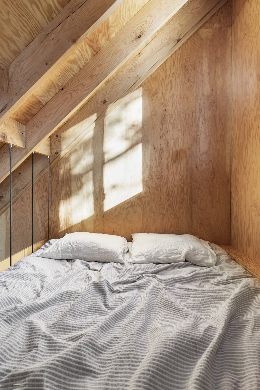 Bedroom and Bed The bed is suspended in the cathedral ceiling, overlooking the cabin.  La Pointe by L'Abri