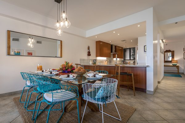 Dining Room, Chair, Table, Floor Lighting, Bar, Storage, Recessed Lighting, Stools, and Ceramic Tile Floor Open kitchen to dining room  Maui Modern, Budget-Luxury Remodeled Vacation Rental