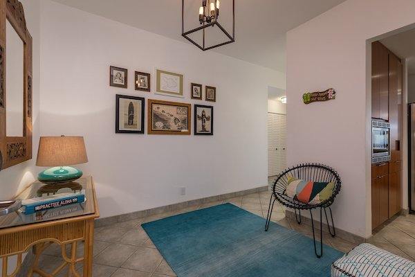 Hallway, Ceramic Tile Floor, and Rug Floor Old and new Hawai'i welcome guests in the entryway.   Maui Modern, Budget-Luxury Remodeled Vacation Rental