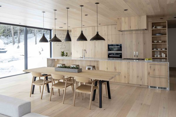 Custom oak clad kitchen integrates wall and floor finishes