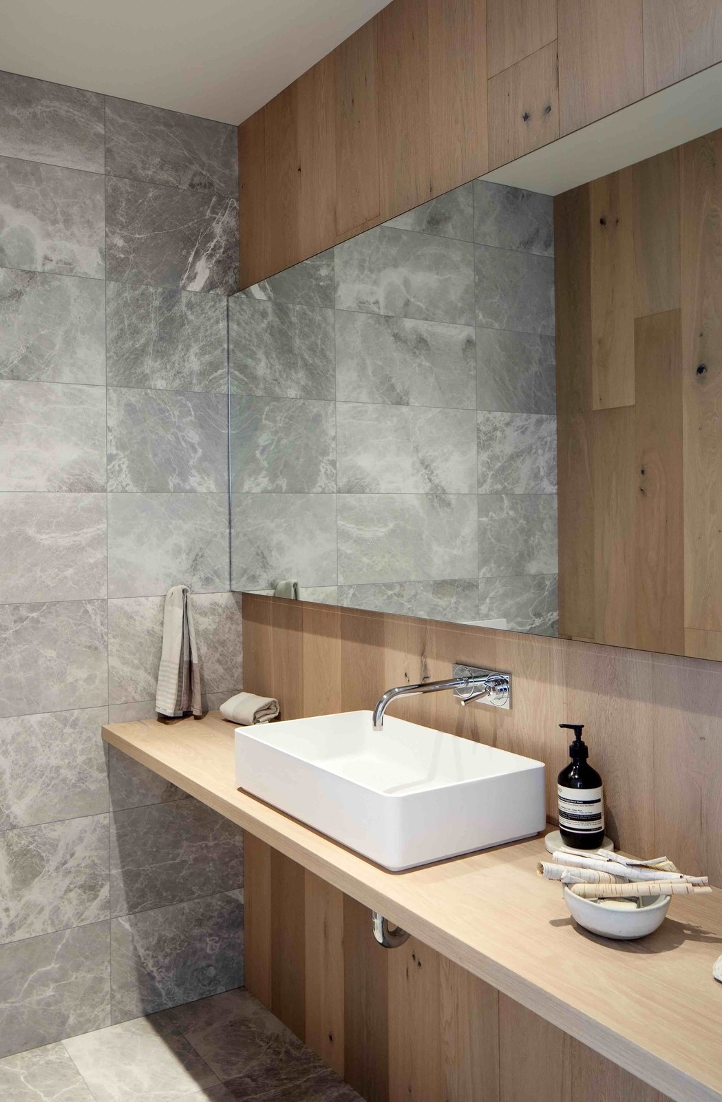 Bath, Vessel, Accent, Marble, Marble, One Piece, and Wood Grey marble and oak panels line powder room walls.  Bath Vessel Accent One Piece Photos from Gilbert House