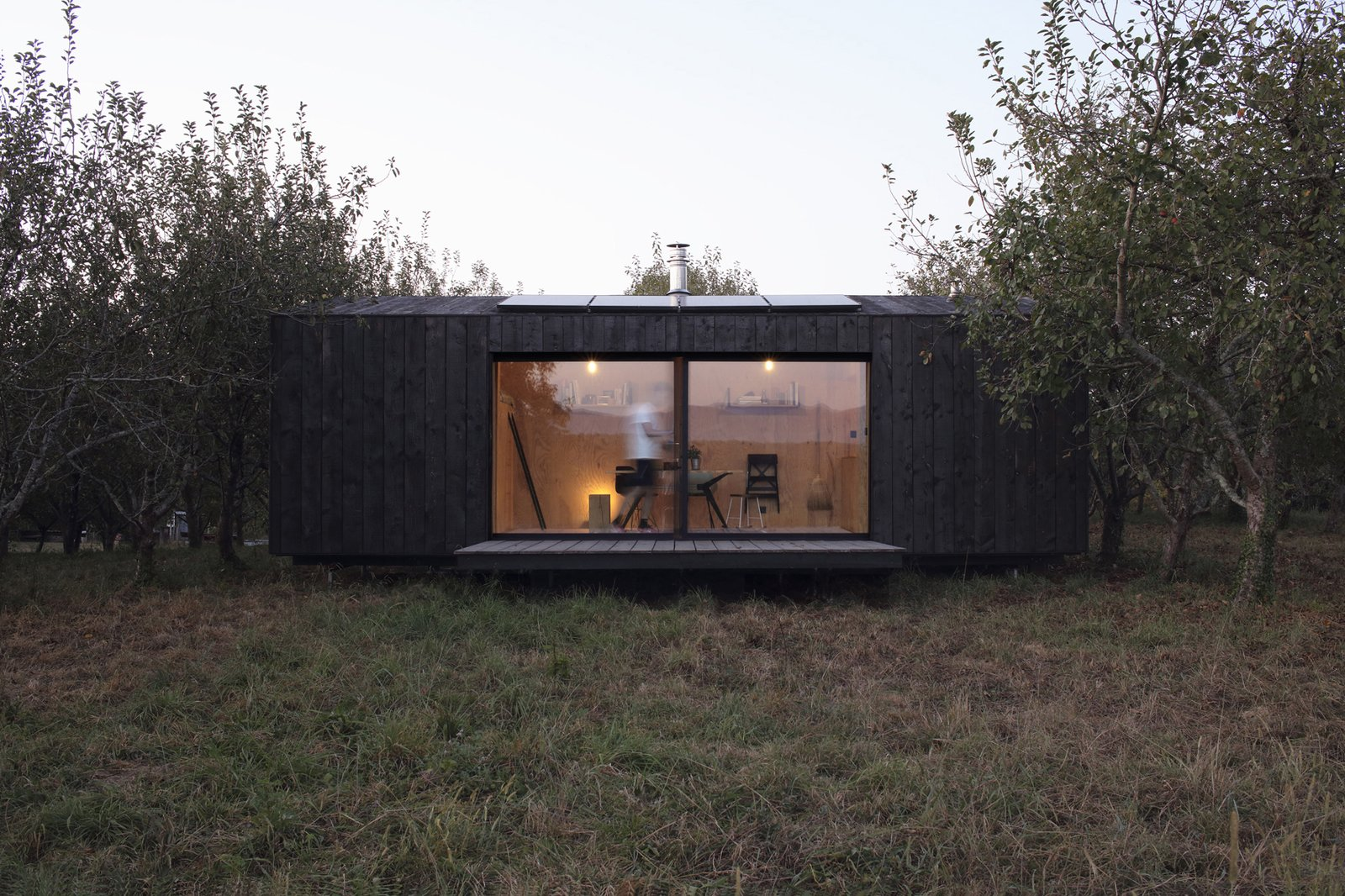 Exterior, Shed RoofLine, Shingles Roof Material, Wood Siding Material, Prefab Building Type, and Cabin Building Type A glimpse of Heva's interior and deck.  heva by A6A