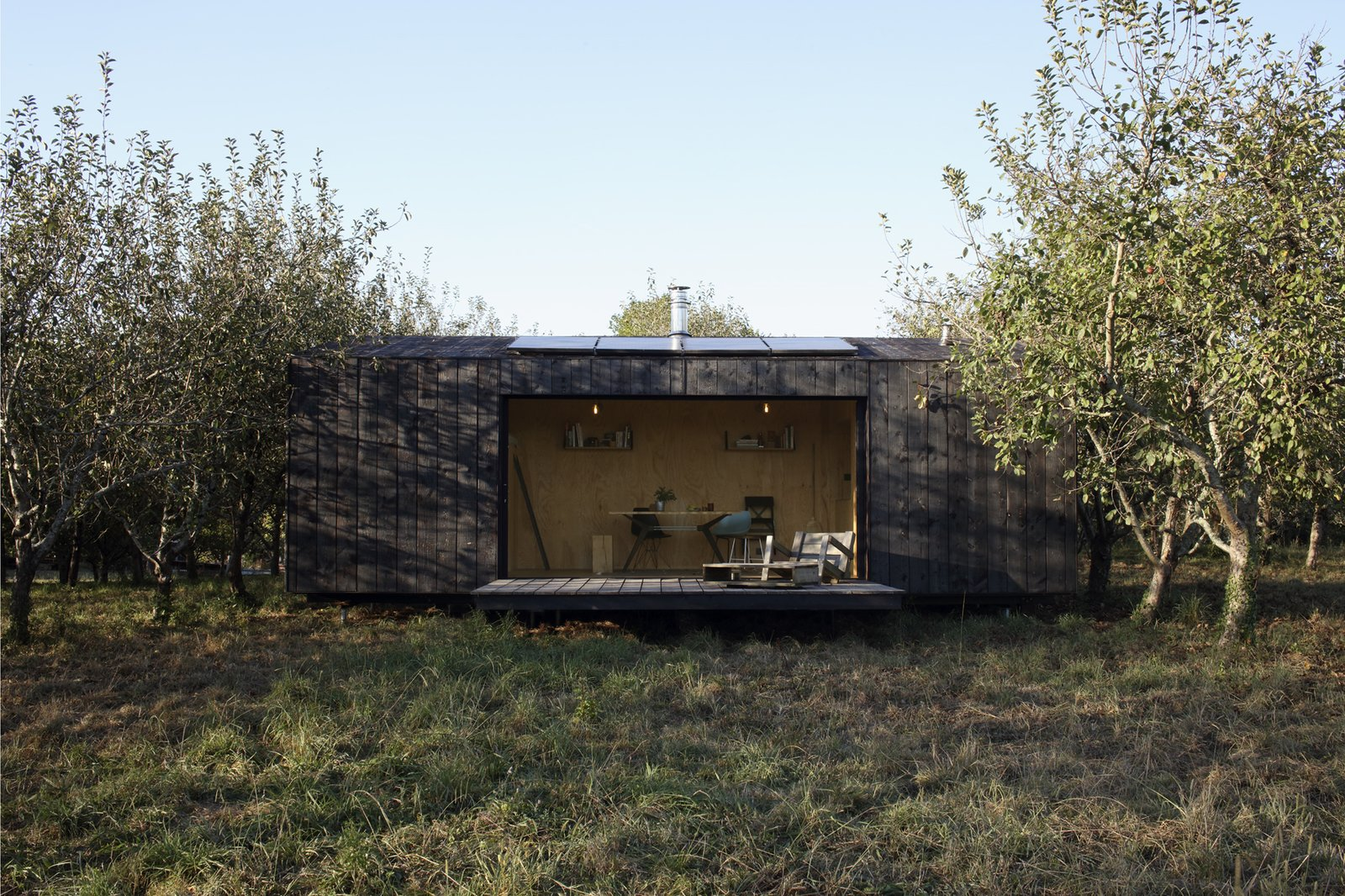 Exterior, Prefab Building Type, Shingles Roof Material, Wood Siding Material, Shed RoofLine, and Cabin Building Type Heva was designed by A6A and manufactured by My Little Loft.  A spacious deck and large glass doors allow for seamless indoor/outdoor living.  Photos from heva