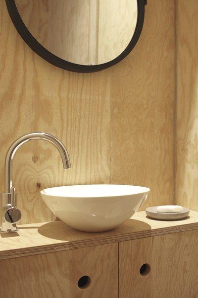 A simple, yet elegant vanity doubles as storage.