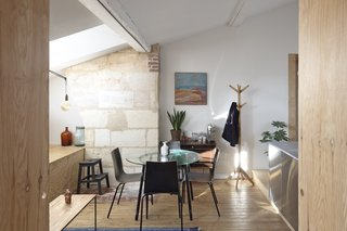 Exposed brick and stone near the dining area pay homage to the building's remarkable history.