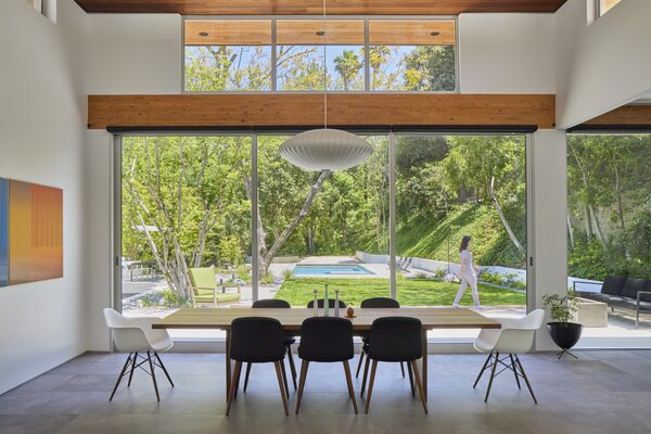 Large sliding doors open the dining room and kitchen to the yard creating a seamless indoor-outdoor experience.