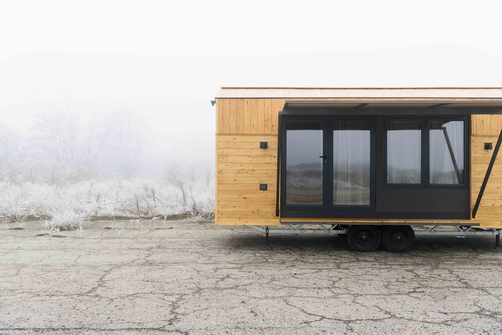 Outdoor Aluminium glazed doors swings open  KOLELIBA Family Tiny House