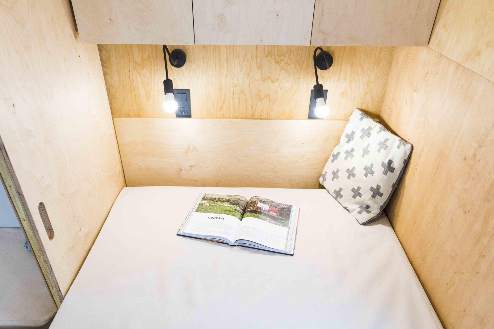 Bedroom, Light Hardwood Floor, Wall Lighting, and Bed Bedroom niche  KOLELIBA Family Tiny House