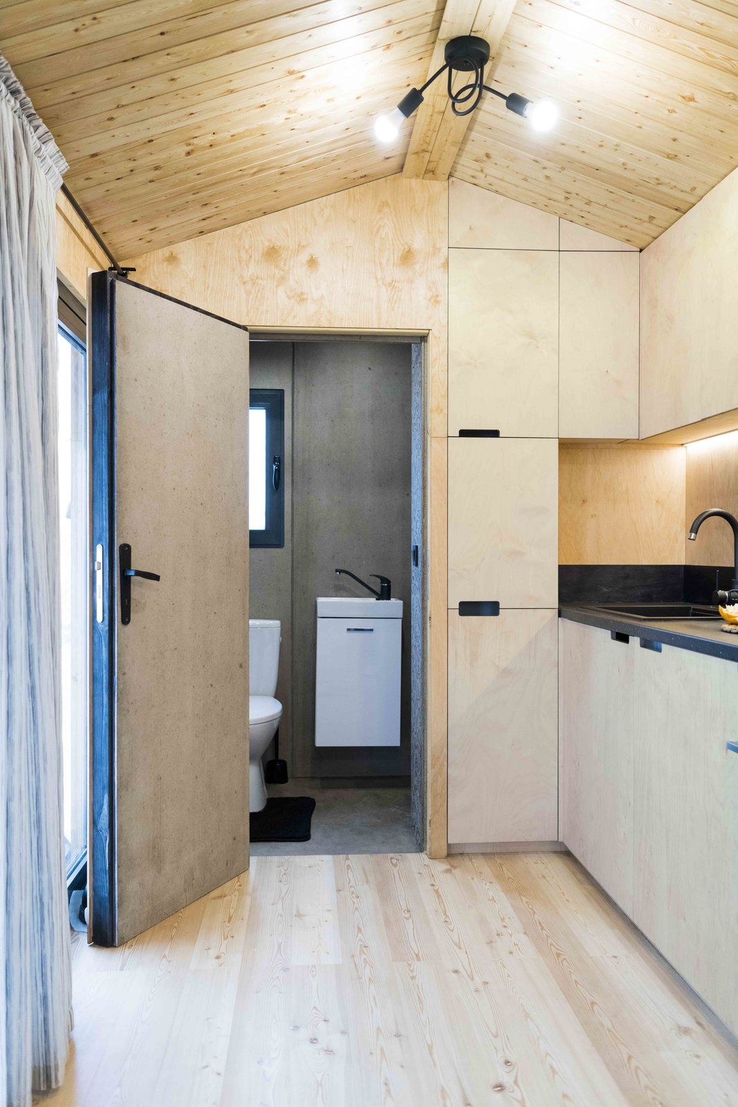 Bath Room, Ceiling Lighting, Wall Mount Sink, and Enclosed Shower Cement fibre boards bathroom  KOLELIBA Family Tiny House