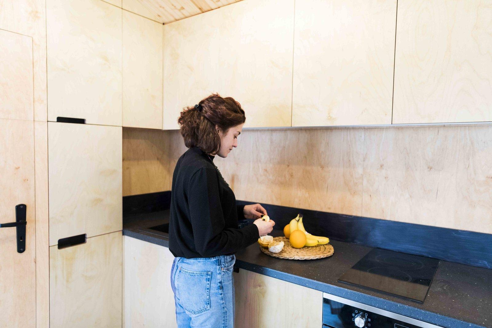 Kitchen, Recessed Lighting, Cooktops, Wood Cabinet, and Light Hardwood Floor Contrasting kitchen worktop  KOLELIBA Family Tiny House