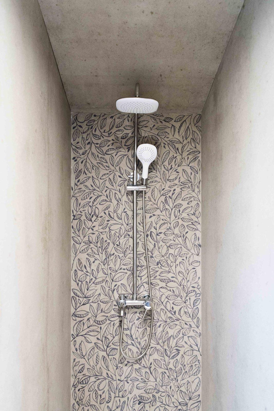 Bath Room, Enclosed Shower, and Concrete Floor Hand-painted shower wall  KOLELIBA Family Tiny House