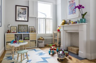 The area at the front of North West London House—which was updated by VORBILD Architecture—became the main living room, whereas the part towards the back is now a children's play room.
