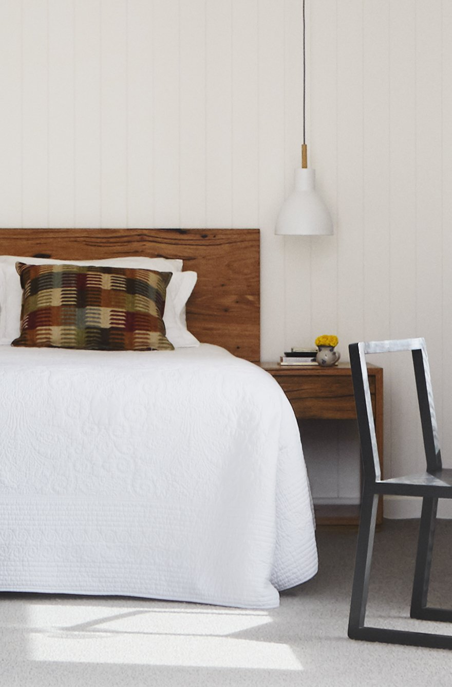 Bedroom, Storage, Carpet Floor, Night Stands, Pendant Lighting, Bed, Accent Lighting, and Chair V-grooved timbers lining boards add texture and warmth to bedroom with solid timber bedhead and side table accents of warmth frame the white of the bedding.   Preston 1