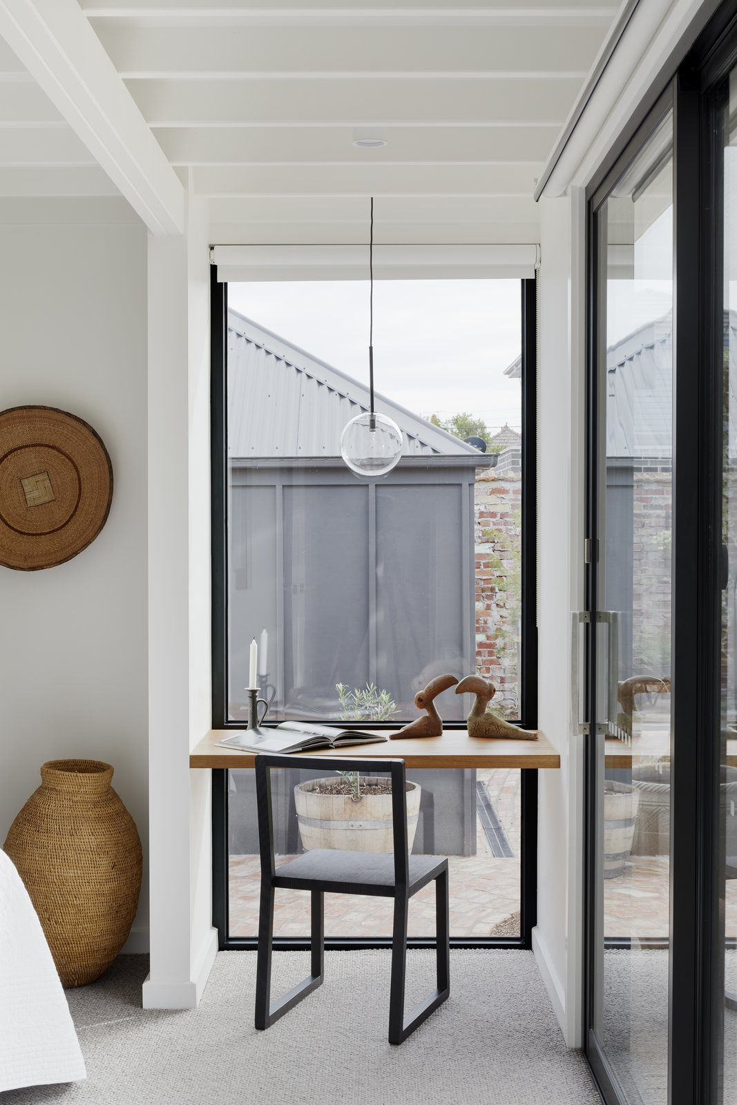 Bedroom, Bench, Chair, Accent Lighting, Pendant Lighting, and Carpet Floor A small nook in the bedroom provides a quiet desk space overlooking the rear garden  Preston 1