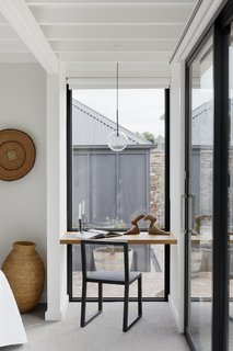 A small nook in the bedroom provides a quiet desk space overlooking the rear garden