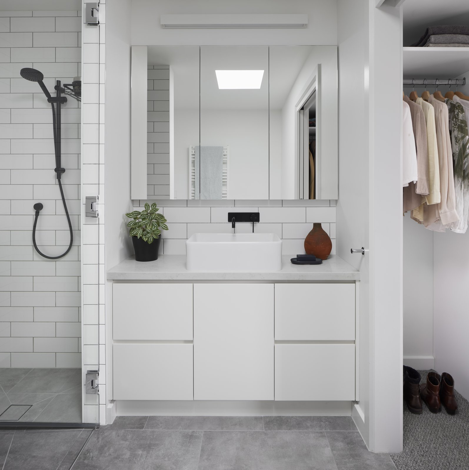 Bath, Ceramic Tile, Subway Tile, Carpet, Open, Porcelain Tile, Vessel, Wall, and Engineered Quartz Simple bathroom and robes with white cupboards and tiling allow light to permeate through the internalised space   Bath Open Engineered Quartz Photos from Preston 1