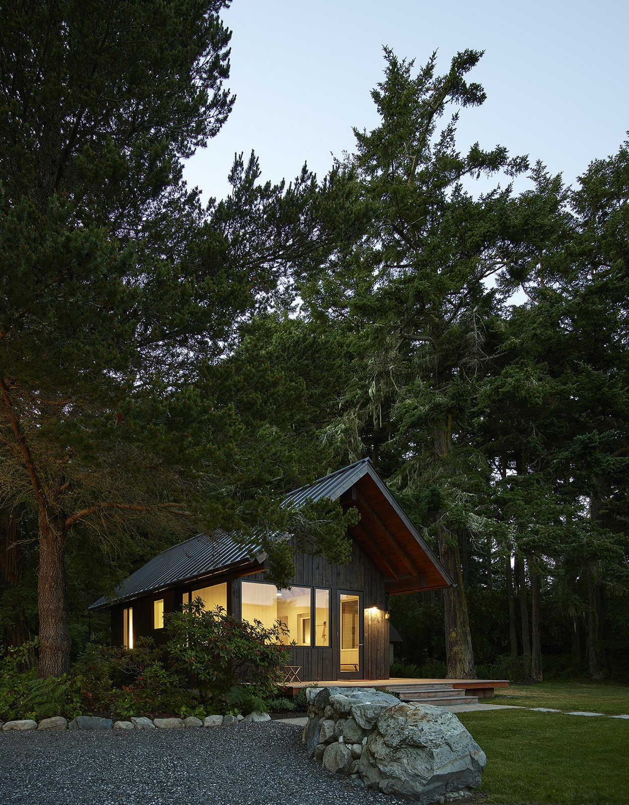 Exterior, Metal Roof Material, Wood Siding Material, Cabin Building Type, and Gable RoofLine Sleeping Cabin at dawn.  Island Cabins by goCstudio