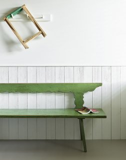 Entry bench and wire-brushed fir wainscoting.