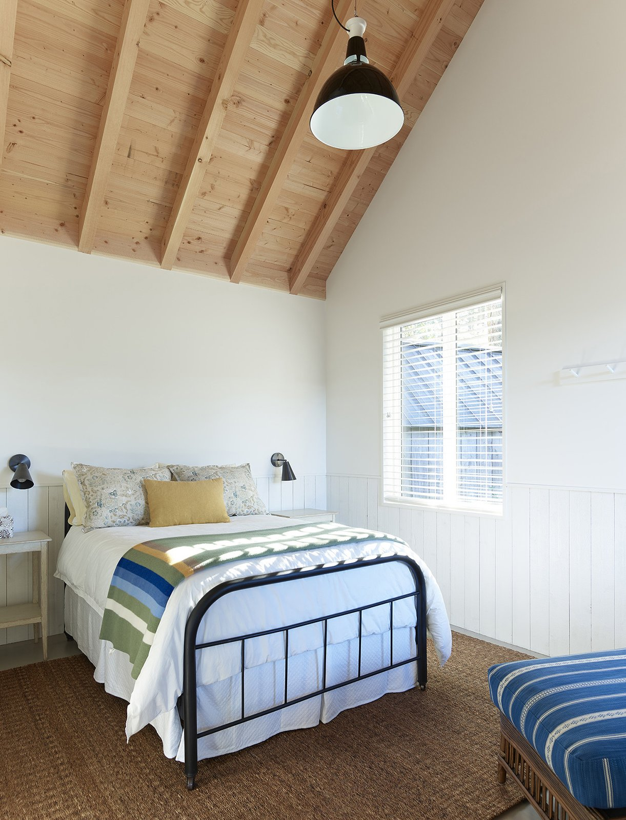 Bedroom, Night Stands, Chair, Wall, Painted Wood, and Bed Sleeping Cabin guest bedroom.  Bedroom Wall Bed Painted Wood Photos from Island Cabins