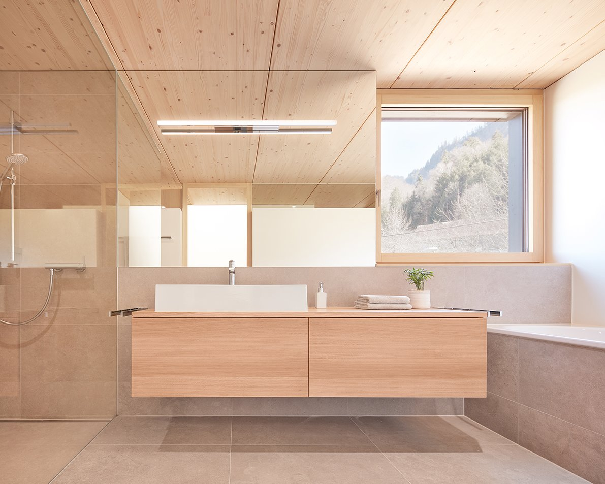 Bath Room, Wall Lighting, Wood Counter, Ceramic Tile Floor, Open Shower, Undermount Tub, Vessel Sink, One Piece Toilet, Ceiling Lighting, and Ceramic Tile Wall Bathroom  Semi detached house on a hillside