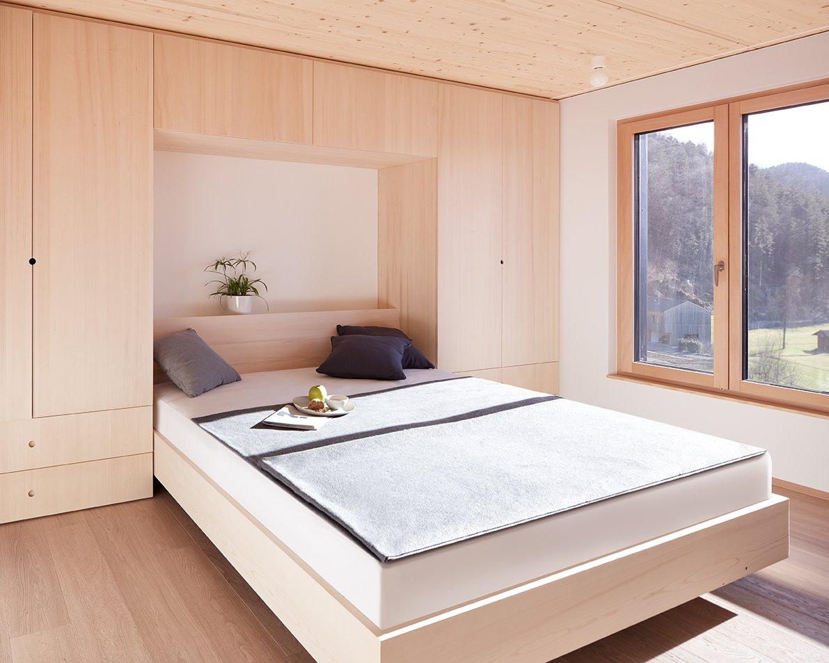 Bedroom, Wardrobe, Bed, Light Hardwood Floor, and Ceiling Lighting Sleeping Room  Best Photos from Semi detached house on a hillside