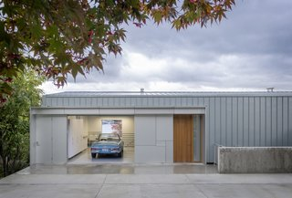 The Portage Bay Residence is a streamlined home that enjoys lake views and total privacy. The garage melds into the industrial, flat exterior, which resembles maritime sheds found throughout the area.