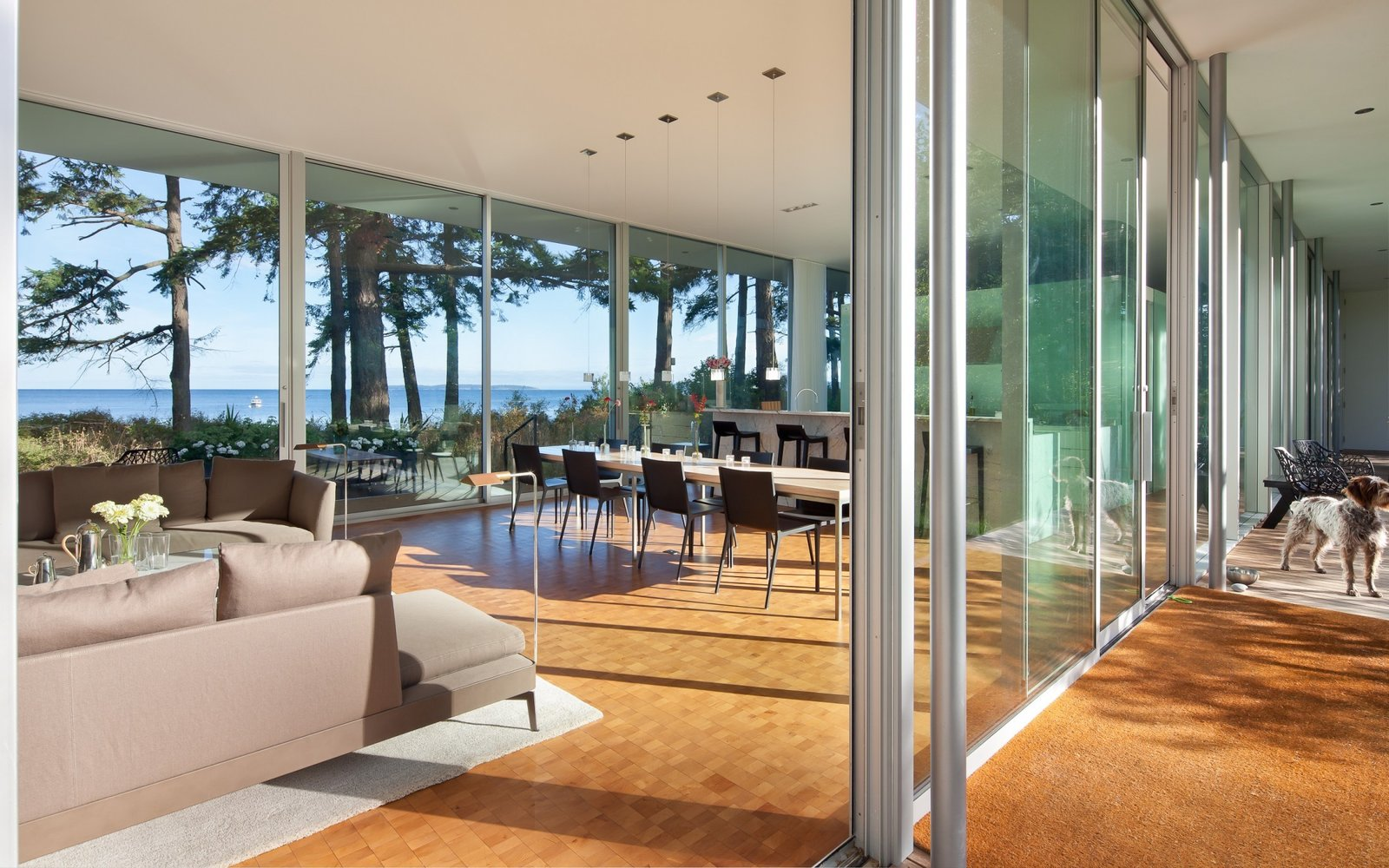 Dining, Accent, Table, Stools, Pendant, Recessed, Chair, Medium Hardwood, and Ceiling View into the open living dining kitchen space and the transparency of the sliding glass doors  Best Dining Table Pendant Accent Stools Chair Photos from North Beach Residence