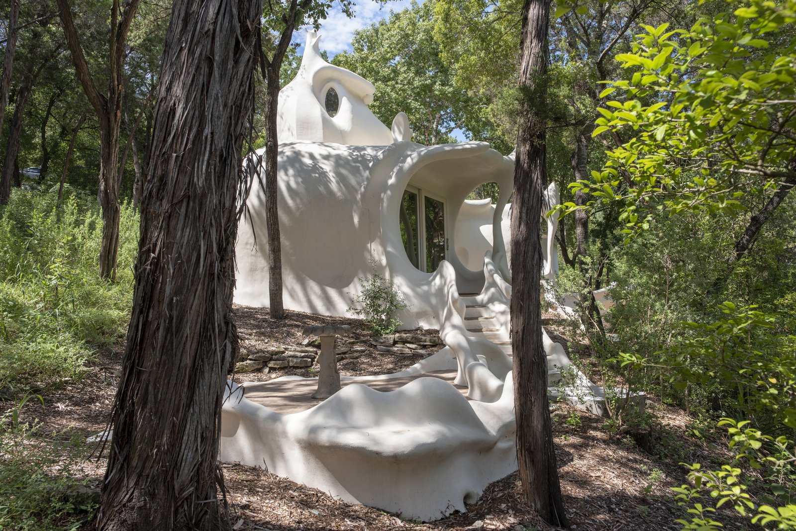 Describing what the Bloom House looks like is tricky; even architect Charles Harker won't reveal what the home is intended to depict.  Photo 1 of 5 in Austin's Weirdest Rental Is a Psychedelic Experience Totally Worth the Trip