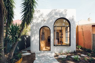 Large windows keep Plaster Fun House bright and breeze-filled. The contrasting stucco and steel frames riff on materials commonly found in older homes in the area.