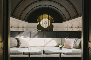 Featuring a neutral color palette of white, beige, black and olive green, the interiors at August pay homage to history, yet still feel modern.