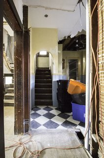 Before: The closed-off kitchen is located in the back of the house on the first floor near the main staircase.