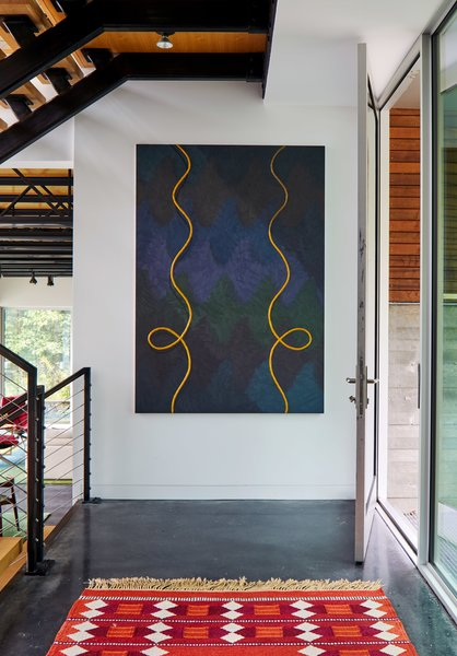 Alex Olson's Cast, which is oil and modeling clay on canvas, hangs above a vintage Swedish rug.