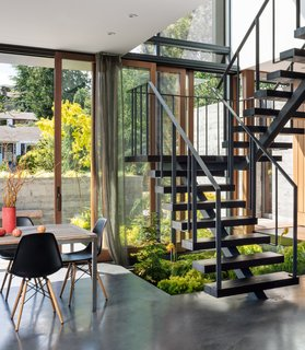 The custom-made steel and Douglas fir staircase leads up to the bedrooms.