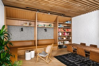 The wood-slatted library is soundproofed for ultimate comfort.